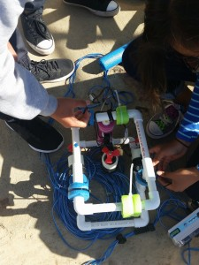 Students attach floats to add buoyancy to their ROVs.